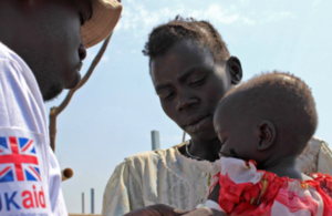 A child is screened for malnutrition in South Sudan. Picture: Nick Stanton/ International Medical Corps
