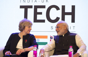 Prime Minister Theresa May and Indian Prime Minister Narendra Modi speaking at the India-UK Tech Summit