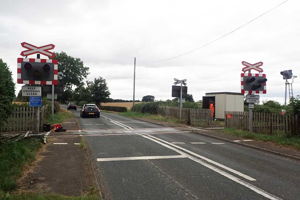 The road traffic signals at Yafforth level crossing for the road approach from the south