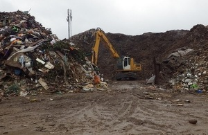 A picture of the waste pile at the site.
