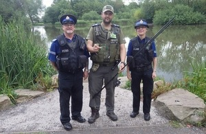 An Environment Agency Fishery Enforcement Officer and 2 PCSO's.