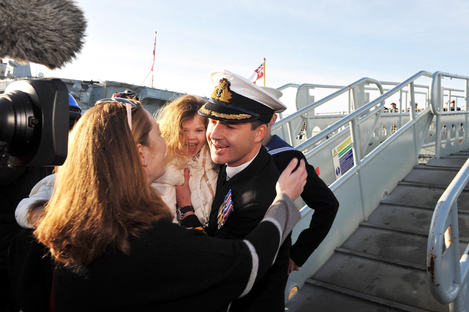 Commander Ian Clarke is greeted by his family