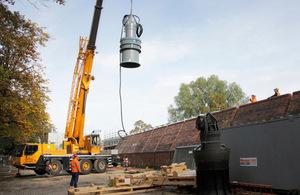 Crane installing a pump