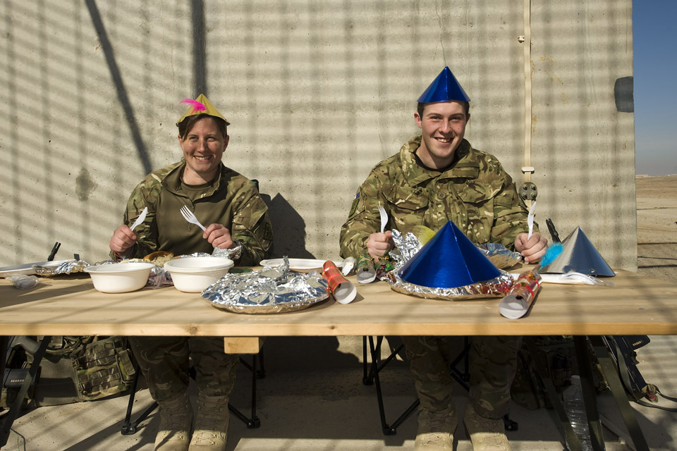 Flight Lieutenant Leah Parle from Banbury (left) and Signaller Alex Williams from Newport, enjoying Christmas Dinner in Camp Bastion.