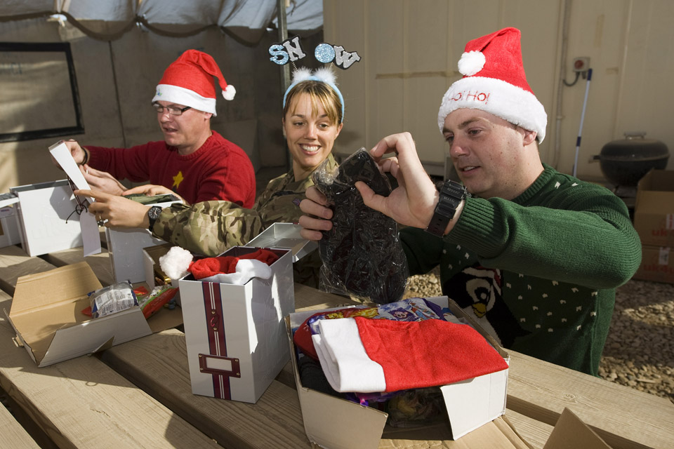Warrant Offficer Class 2 Andy Morris, Lance Corporal Thelma Goddard and Lance Corporal Rory Mortimer opening parcels on Christmas morning