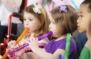 Primary school children playing recorders