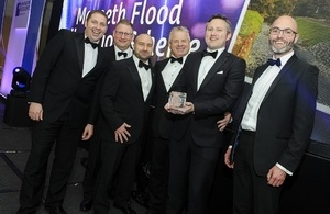 Image shows the award being collected on the night