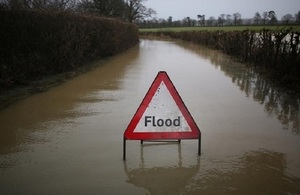 Image shows a flooded road