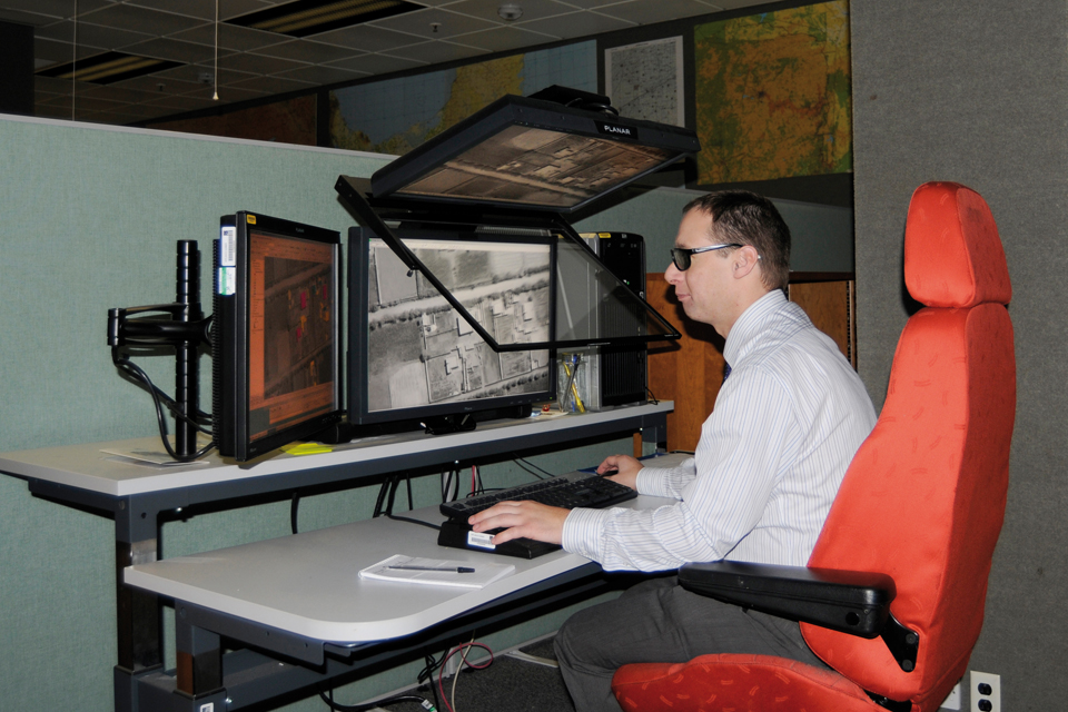 A geospatial analyst using stereographic imagery
