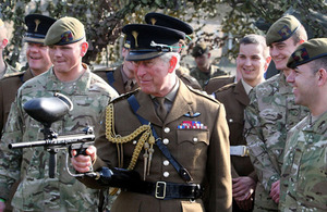 His Royal Highness The Prince of Wales fires a paintball gun during his visit to the 1st Battalion Welsh Guards at their barracks in Hounslow, Middlesex [Picture: Steve Parsons/PA Wire 2012]