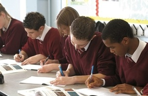 Pupils writing in exercise books