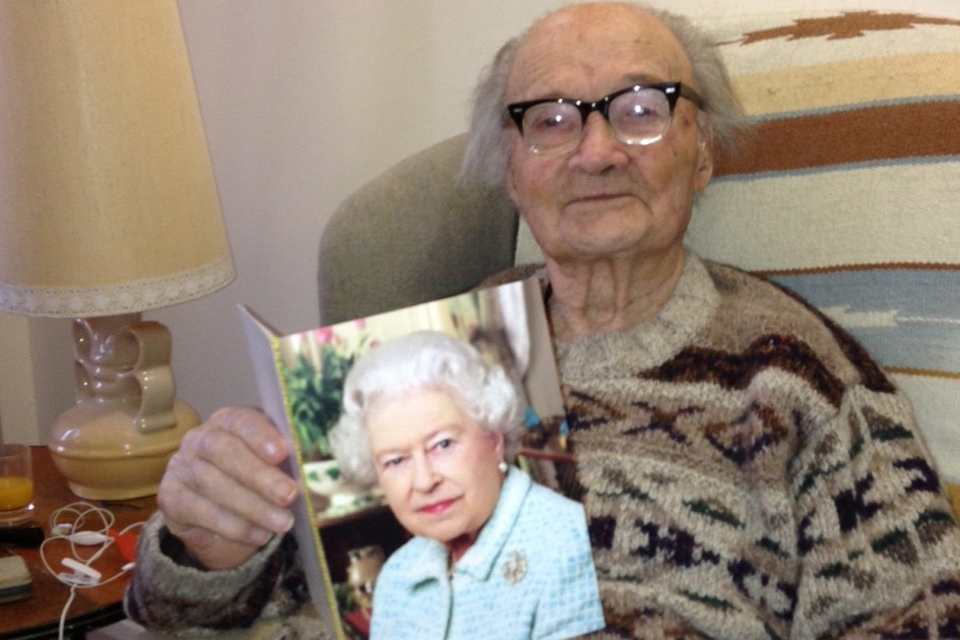 Mieczyslaw Juny with his birthday card from Her Majesty The Queen
