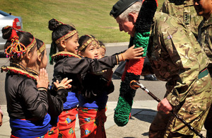Children present Prince Charles with a garland on his arrival at Sir John Moore Barracks in Folkestone - regimental home of the Royal Gurkha Rifles [Picture: Corporal Mike O'Neill, Crown Copyright/MOD 2012]