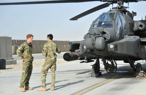 Prince Harry standing next to an Apache helicopter at Camp Bastion in Afghanistan [Picture: Corporal Paul Morrison, Crown Copyright/MOD 2012]