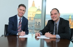 Gordon Welsh (UKEF) and Fred Smyth (Bank of Ireland) sign the agreement