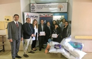 Ambassador Jeremy Hobbs and his wife Eréndira Hobbs delivering donations to the National Cancer Institute