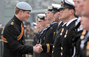 His Royal Highness Prince Harry presents Operation TELIC medals to members of HM Ships Grimsby, Middleton and Pembroke  [Picture: LA(Phot) Jenny Lodge, Crown Copyright/MOD 2011]