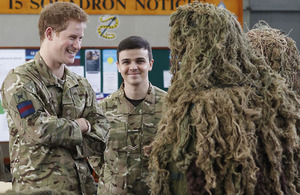 Prince Harry talking to RAF Regiment snipers in ghillie suits during his visit to RAF Honington [Picture: Corporal Jim MacDonald RAF, Crown Copyright/MOD 2012]