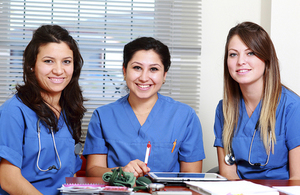 3 young female health professionals completing paperwork