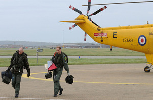 The Captain of 'Rescue 122' (left) and Flight Lieutenant William Wales discuss the rescue mission they have just completed [Picture: Senior Aircraftman Dek Traylor, Crown Copyright/MOD 2010]