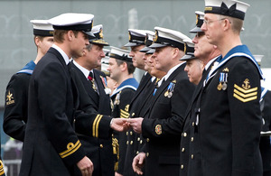 His Royal Highness Prince William presents gold pins to sailors who have served on nuclear deterrent patrols  [Picture: POA(Phot) Ian Arthur, Crown Copyright/MOD 2010]
