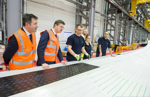 Greg Clark examines a wind turbine blade in the factory