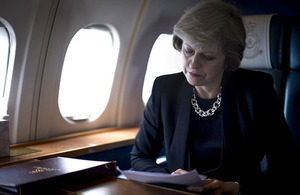 Prime Minister travelling on a plane
