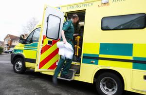 A paramedic getting in an ambulance