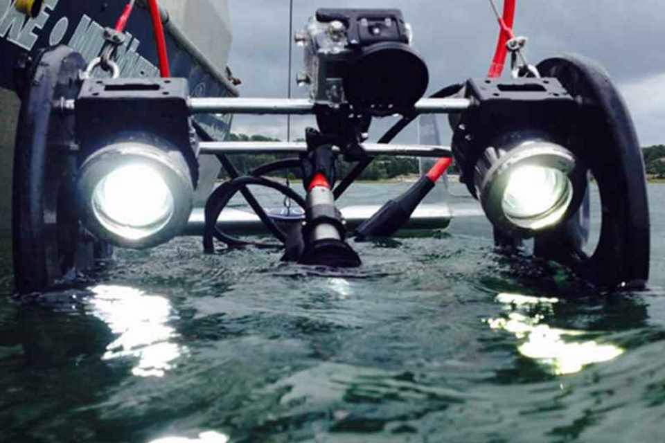 Unmanned marine survey vehicle entering the water.