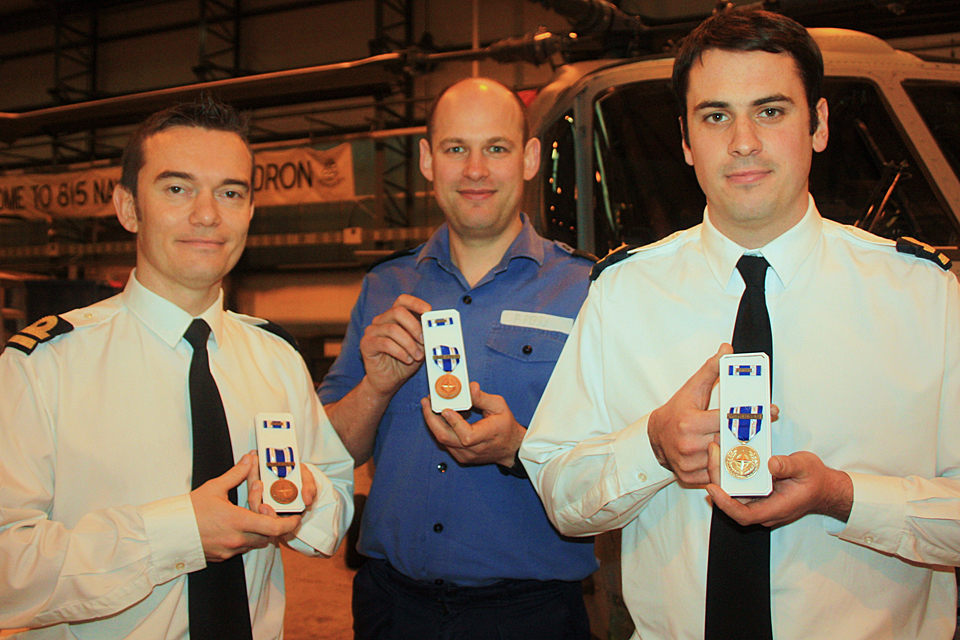 Naval Air Squadron personnel with their Operation Unified Protector medals