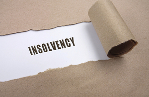Envelope being torn revealing word insolvency