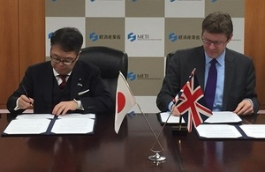 Business Secretary Greg Clark and Japan Economy Minister Hiroshige Seko sign memorandum in Tokyo