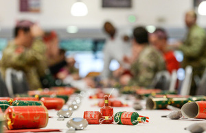 Troops enjoying a Christmas dinner with crackers