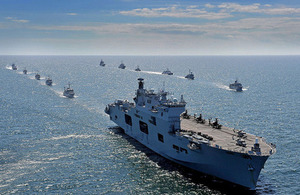 The Helicopter Carrier HMS Ocean during Exercise BALTOPS 2015. She has AH1D Apache Attack, and Wildcat helicopters on her flight deck and has ships from the 17 partner nations that took part in the exercise following behind.