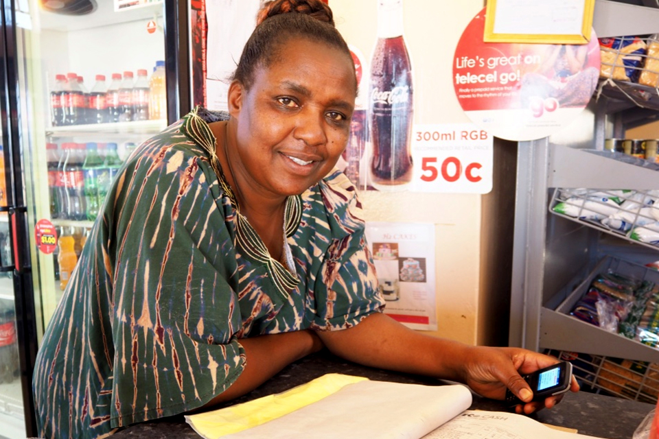 Penina Moyo, a shopkeeper in Umguza signed up as an EcoCash vendor on the mobile money transfer programme last year. Picture: Mira Gratier/DFID