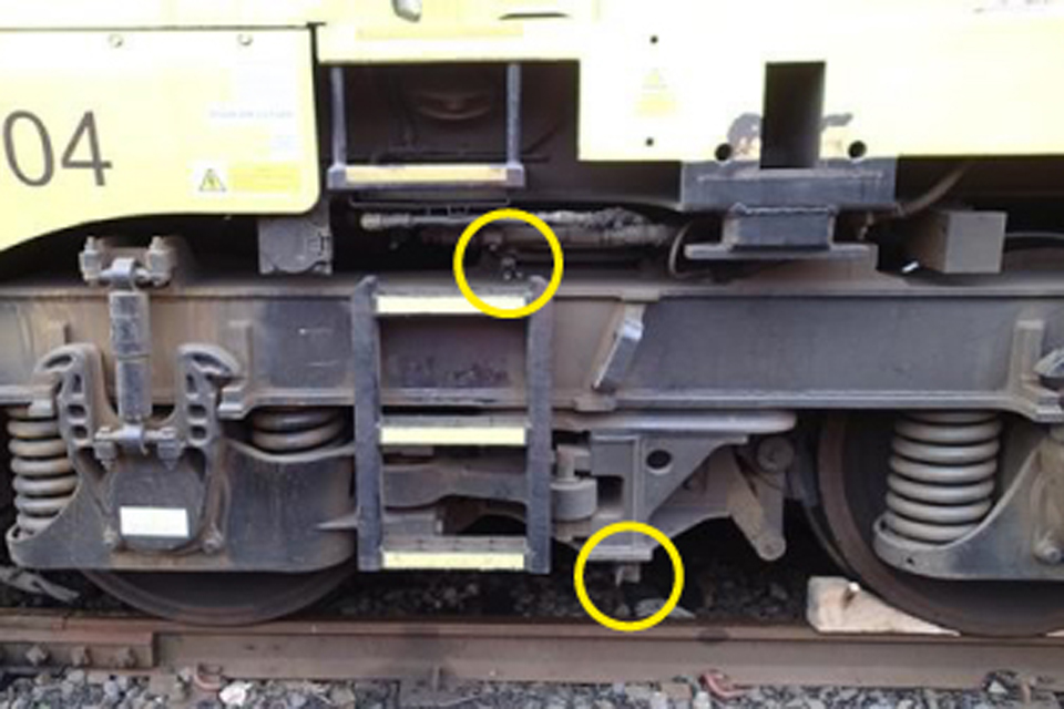 Location of parking brake isolation handle (circled bottom) and bogie brake isolation valve (circled top)