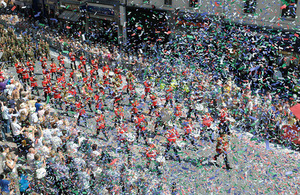 Confetti flies over the Armed Forces Day crowds