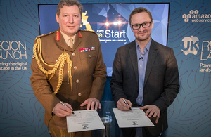 General Sir Chris Deverell co-signs the Covenant with Gavin Jackson, UK Managing Director at AWS.
