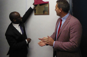 Sam Gyimah unveiling a plaque for the opening of the academy with James Timpson.
