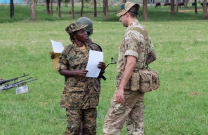 A member of the British Peace Support Team East Africa instructs a Ugandan soldier at Singo