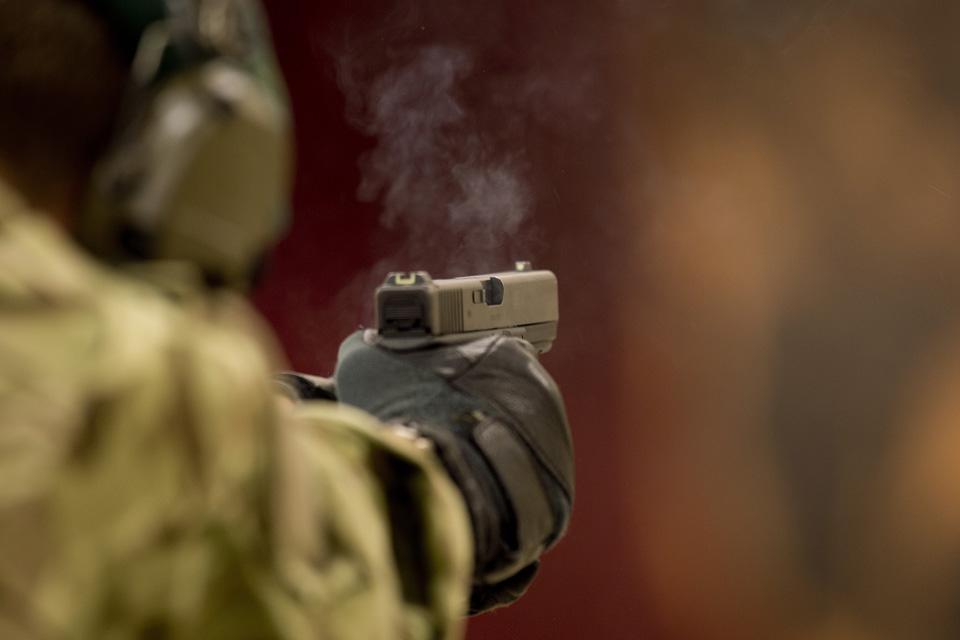 A Glock pistol is fired on a range