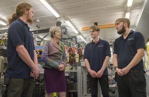 Prime Minister Theresa May speaking with young workers at Sci-Tech in Daresbury.