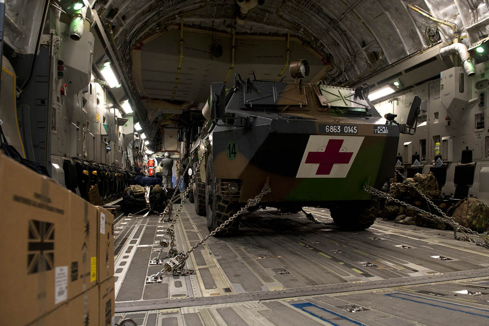 French military equipment in the cargo hold of a Royal Air Force C-17 transport aircraft