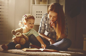 Mother reading her child a book