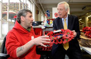 Earl Howe meets Gregg Howell, who makes poppies and wreaths at the Poppy Factory.