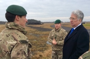 Secretary of State for Defence Sir Michael Fallon with Royal Marines from 45 Commando
