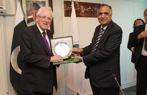The Lord Mayor of London, Alderman Dr Andrew Parmley, receiving a shield from Muhammad Zafar-ul-Haq Hijazi, Chairman of the Securities and Exchange Commission of Pakistan after their meeting in Islamabad.