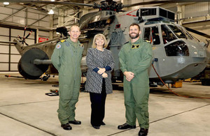Defence Minister Harriett Baldwin at the 849 Naval Air Squadron hangar in front of a Sea King helicopter. Crown Copyright.