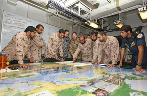 Emirati staff conducting a planning exercise in HMS Ocean prior to the Ex SEA KHANJAR 17 final assault