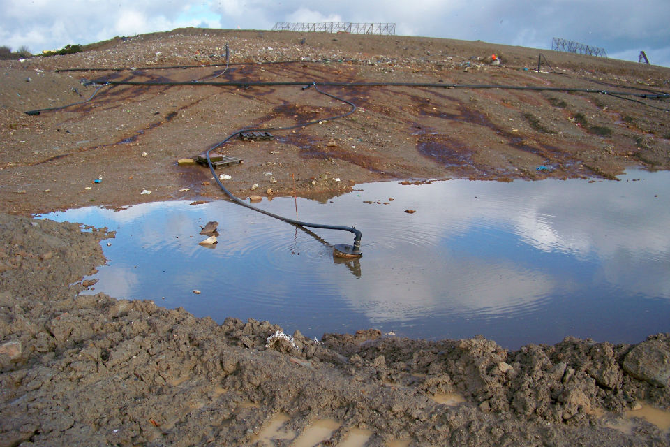 Image of a large, brackish puddle that was the cause of strong smells